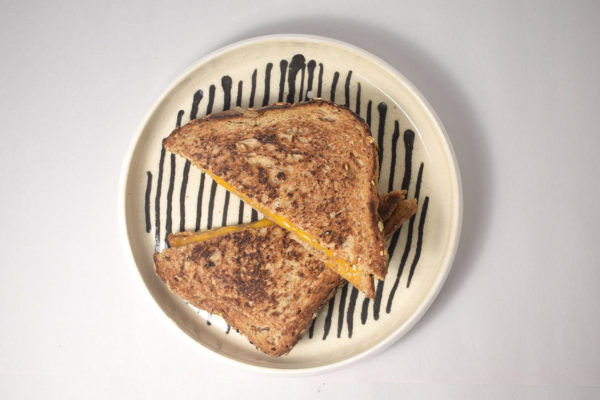 Hand made ceramic plate with grilled cheese sandwich