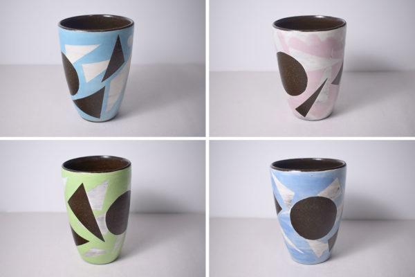 Four ceramic tumblers