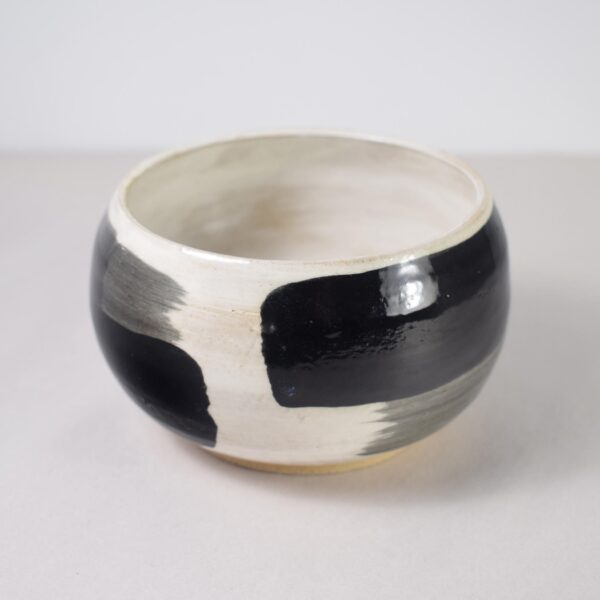 Painted black and white ceramic bowl
