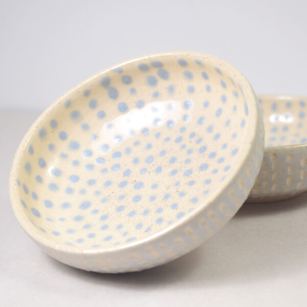 Two ceramic sauce bowls decorated in light blue